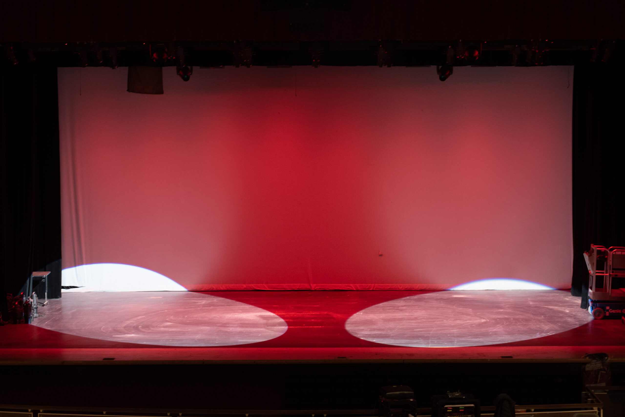 Red backlights and white spotlights on a stage