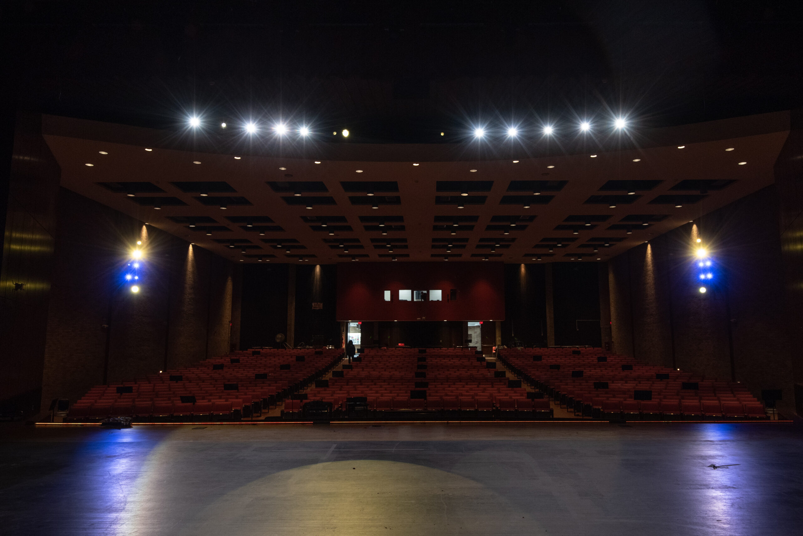 View of lighting system from the stage with upper lights visible and the whole auditorium